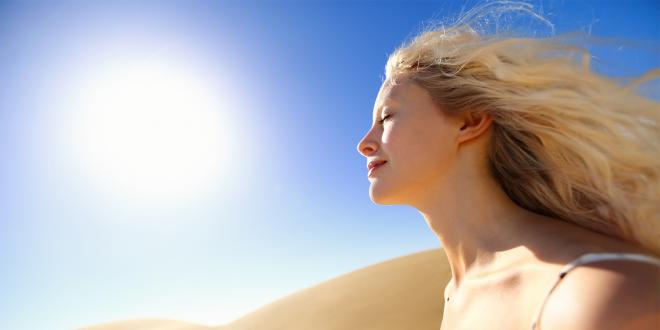 A woman in the desert heat, with beautiful youthful skin